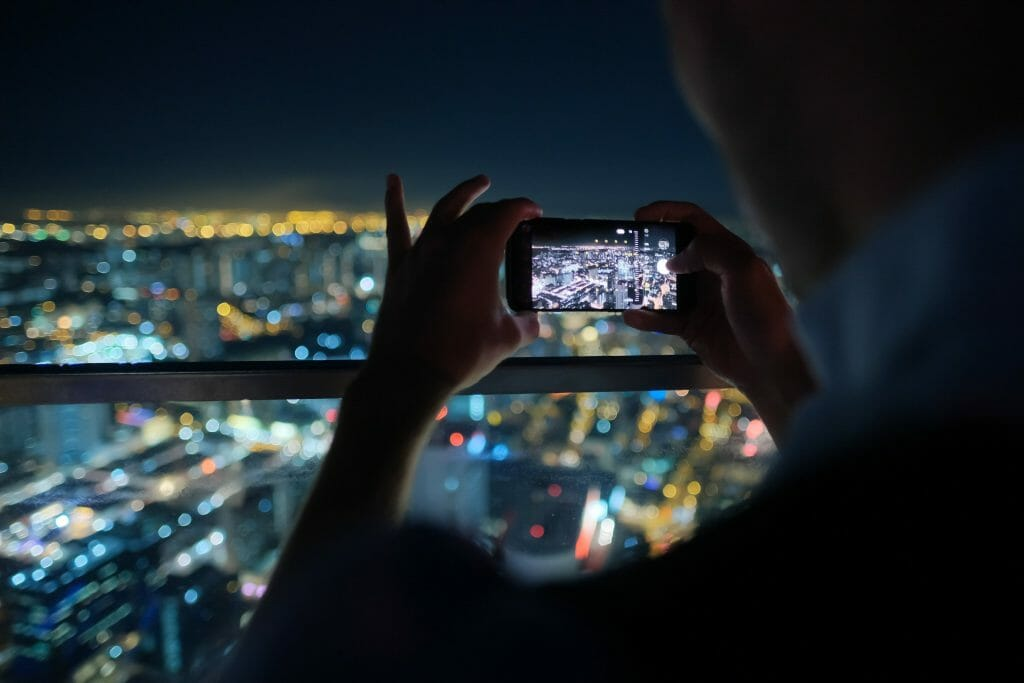 Individual using a cell phone for surveillance